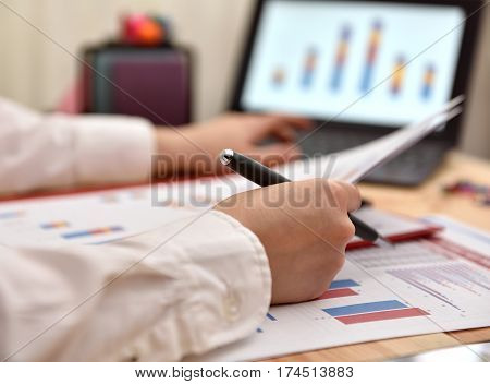 Businesswoman Compares The Data