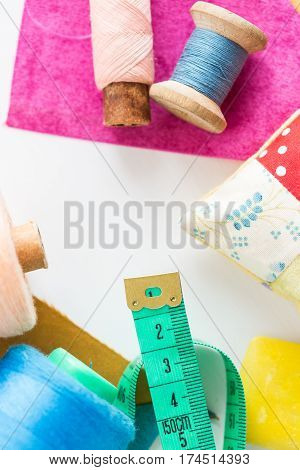 tool kit for cutting, sewing and production of scrappy blankets, quilt and fabric on a white background with a blank space under an inscription in the middle. Top view, Flat Lay. set of the tailor