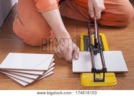 Tile Cutter On The Floor