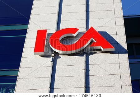 Solna Sweden - October 6 2016: The ICA logo at the ICA group headquarters at the street Svetsarvagen.