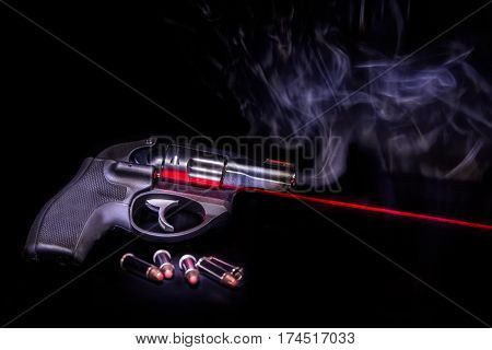 A .38 special handgun with laser sights.