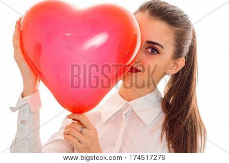 young girl keeps near big balloon sweetheart close-up isolated on white background