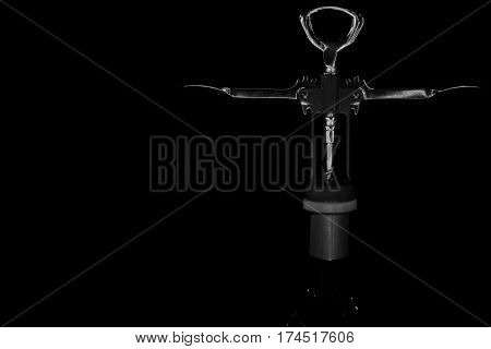 A corkscrew opening a bottle of wife.