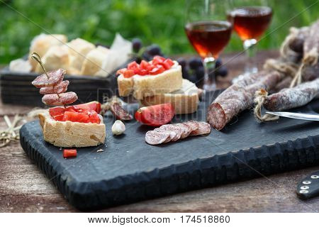 Cured Dry Sausage With Wine, Bread And Tomato