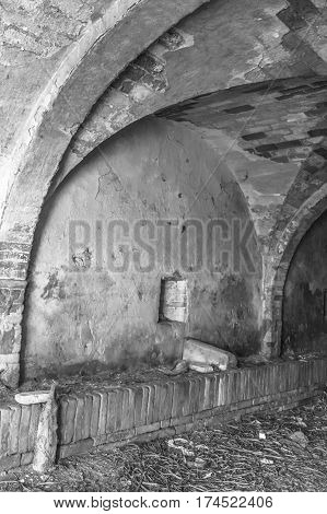 black and white interior view of an abandoned house