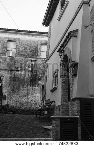 black and white view of a tipical alley in Italy