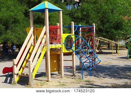 Children's playground. Swing. Walk in the park