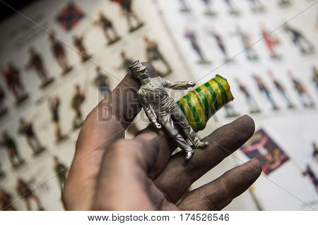Saint-Petersburg Russia - February 21 2017: A small factory producing small batches pewter figurines. The figure of a warrior in the hands of the master