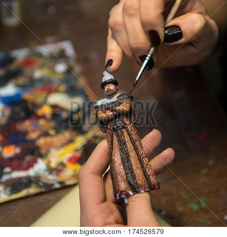 Saint-Petersburg Russia - February 21 2017: A small factory producing small batches pewter figurines. painting the figure of a nobleman