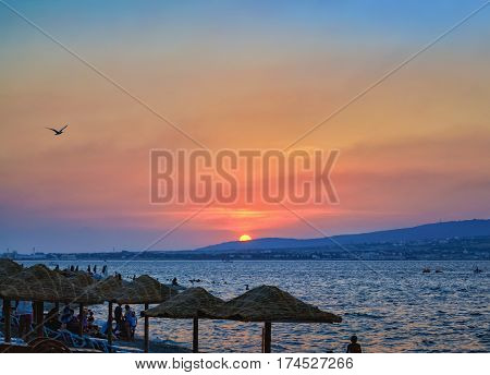 Sunset Overlooking Sea Bay And Beach With Parasols, Black Sea Coast, Gelendzhik, Russia