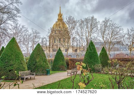 PARIS, FRANCE - DECEMBER 26, 2012 : In the park near Rodin Museum, Tombeau de Napoleon Ier Tomb of Napoleon I is seen at background, Paris, France