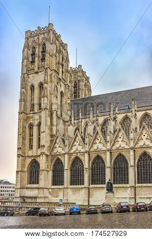 BRUSSELS, BELGIUM - JANUARY 05, 2013 : Place Sainte-Gudule with statue of Cardinal Desire-Joseph Mercier in front of St Michael and St Gudula Cathedral, view from Rue de la Chancellerie