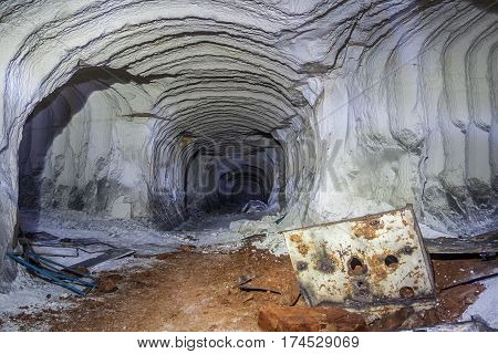 Abandoned chalk mine tunnel with bizarre traces of drilling machine and remnant of equipment, Belgorod, Russia