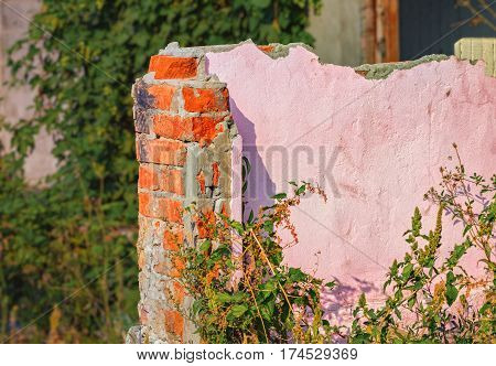 Old ruined brick house fragment as background