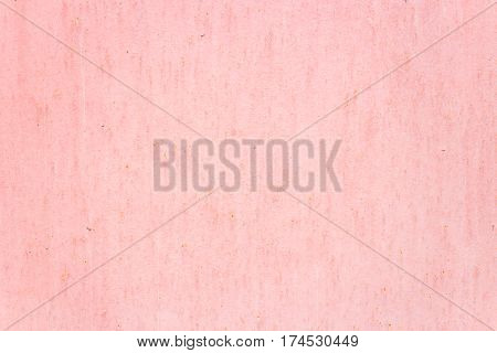 Light pink rough stucco background in the daytime