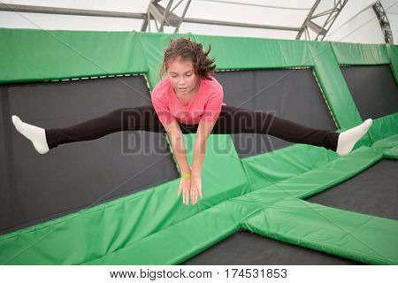 MOSCOW, RUSSIA - AUG 29, 2016: Girl  jumps on trampoline in center Just Jump in Sokolniki park. Trampoline Arena is suitable for both adults and children athletes and fans.