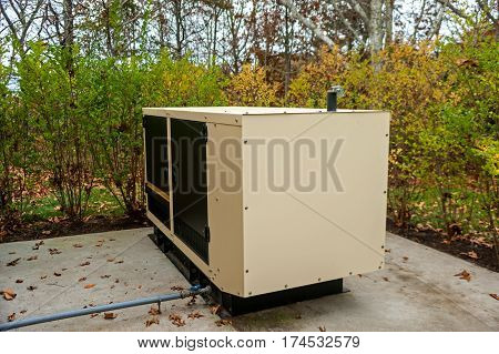 The Residential generator on the concrete pad