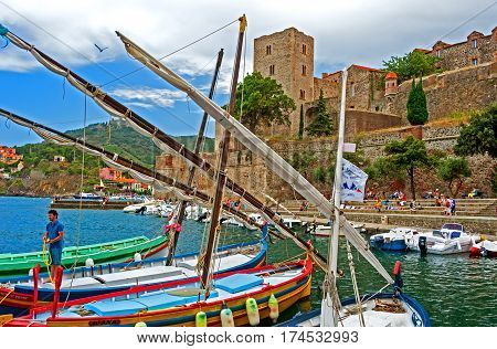 Collioure, France -August 3, 2014:  Boats are docked in Maina of Collioure, most picturesque of the Côte Vermeille resorts
