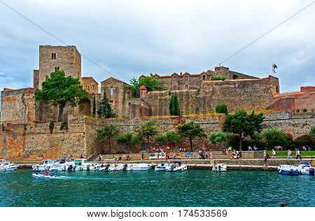 Collioure, France -August 3, 2014:  Boats are docked in Marina of Collioure, most picturesque of the Côte Vermeille resorts