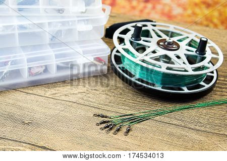 fishing spinning leashes with reel on the wooden table
