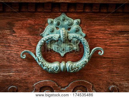 Ornate Brass Door Knocker On A Vintage Wooden Door