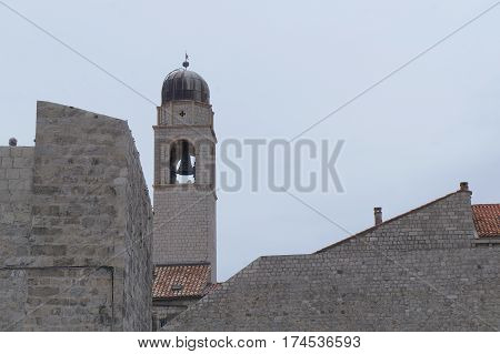 Clock tower built in 15 century in Stradun street in Dubrovnik, Croatia in gloomy evening