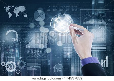 Hand of businessman touching a virtual button by using a stylus pen on the futuristic screen
