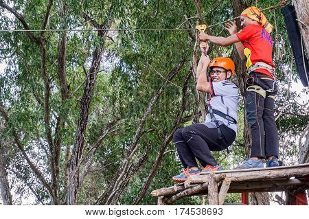 Labuan,Malaysia-Feb 12,2017:Adventurer man ready to play on a flying fox in Labuan,Malaysia.There will be more ziplines in Malaysia,especially when there have so much natural resources & rainforest.