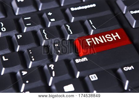 Image of red button with finish word on the computer keyboard