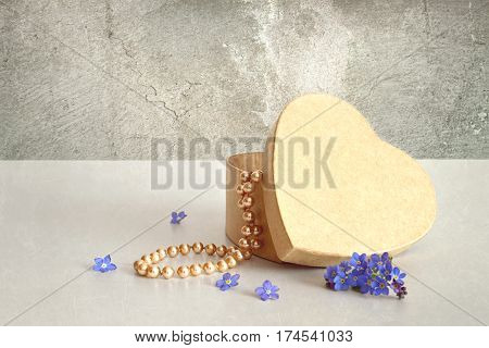 Happy Mothers Day card: Heart shaped gift box and pearls