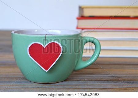Cup of tea with heart shaped tea bag label