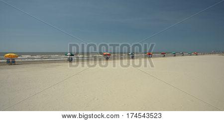 Galveston Texas Beach with Umbrellas Lining the Surf