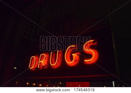 Old Neon Red Drug Store Sign at NIght