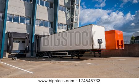 Truck Trailers At A Dock