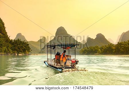 Tourists Cruising Li River In Yangshuo, China