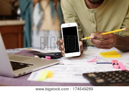 Cropped View Of Casual African-american Man Pointing Pencil At Blank Copy Space Screen Of Mobile Pho