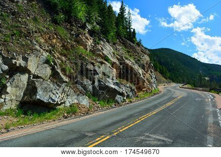 Long and Winding Curvy Mountain Road with Rock Slide Fencing