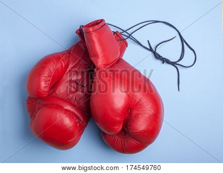 red boxing mitts isolated on blue background