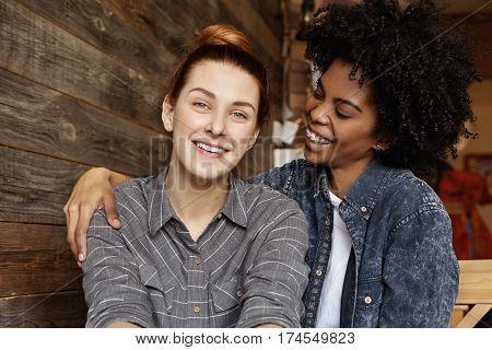 Stylish Young Interracial Lesbian Couple Enjoying Time Together, Hugging And Cuddling During Long-aw