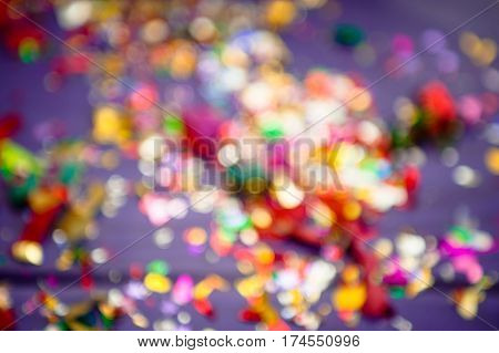 concept of holiday. background is out of focus. colored confetti