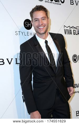 LOS ANGELES - FEB 26:  Justin Hrtley at the 25the Annual Elton John Academy Awards Viewing Party at the  City of West Hollywood Park on February 26, 2017 in West Hollywood, CA
