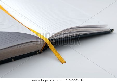 Blank Open Notebook With A Yellow Tab