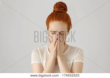 Portrait Of Unhappy And Depressed Young Caucasian Woman With Ginger Hair Feeling Ashamed Or Sick, Co