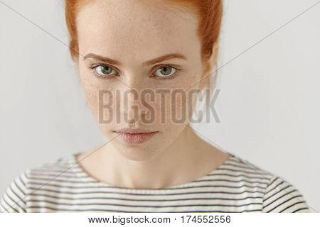 Close-up Highly-detailed Portrait Of Amazing Young Redhead Female Model With Green Eyes And Clean He