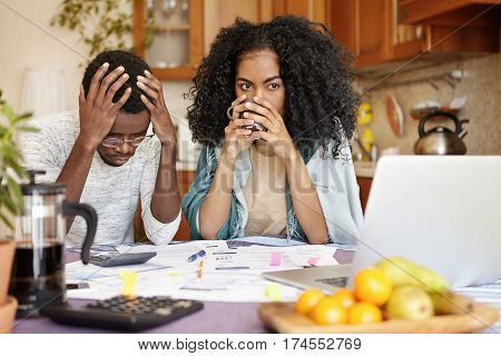 Young Dark-skinned Family Facing Financial Stress, Not Able To Pay Off Loan In Bank. Depressed Afric
