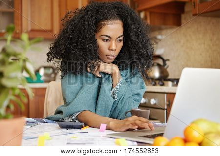Beautiful Young Dark-skinned Woman With Afro Hairstyle Wearing Wrap Keeping Hand On Touchpad Of Open
