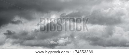Panorama of a gray gloomy sky. Thunderclouds over horizon cloudscape storm.