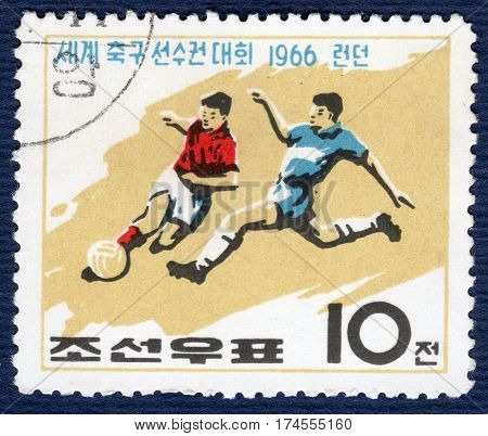 KOREA - CIRCA 1966: Postage stamp printed in Korea with a picture of a football players, with the inscription