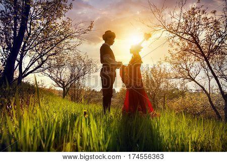 Kazakh Couple In Ethnic Costume At Sunset