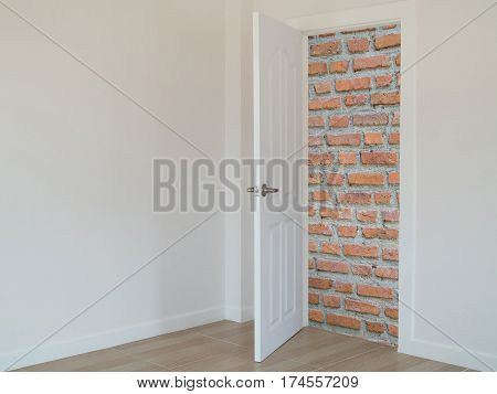 brick wall in front open door concept of no exit and entry.